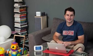 British Gas: Dariusz Bogal with a laptop in his living room