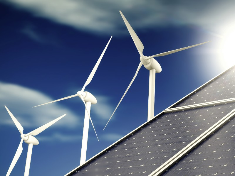 Solar panels and wind turbines are part of the renewable energy transition