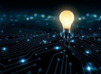 Glowing lightbulb on a digital background