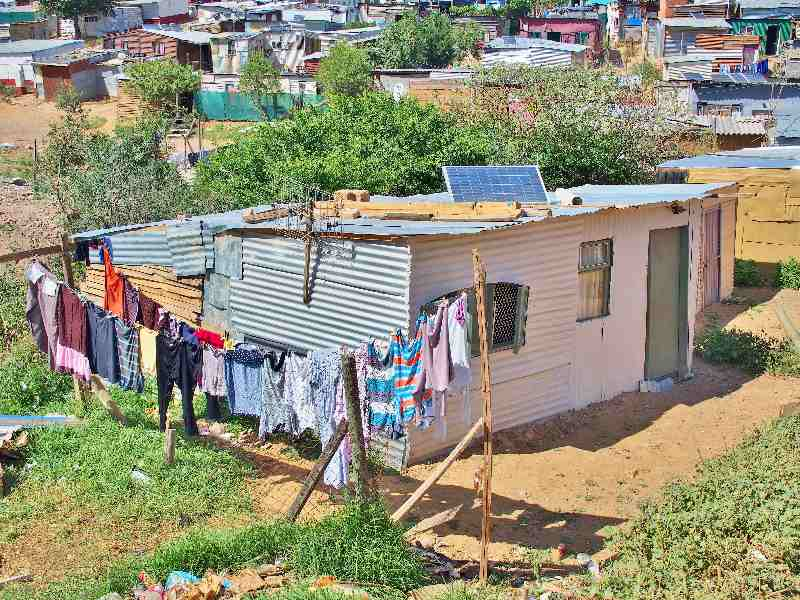People in informal settlements got a solar panel installed in their roof to get energy access in Africa